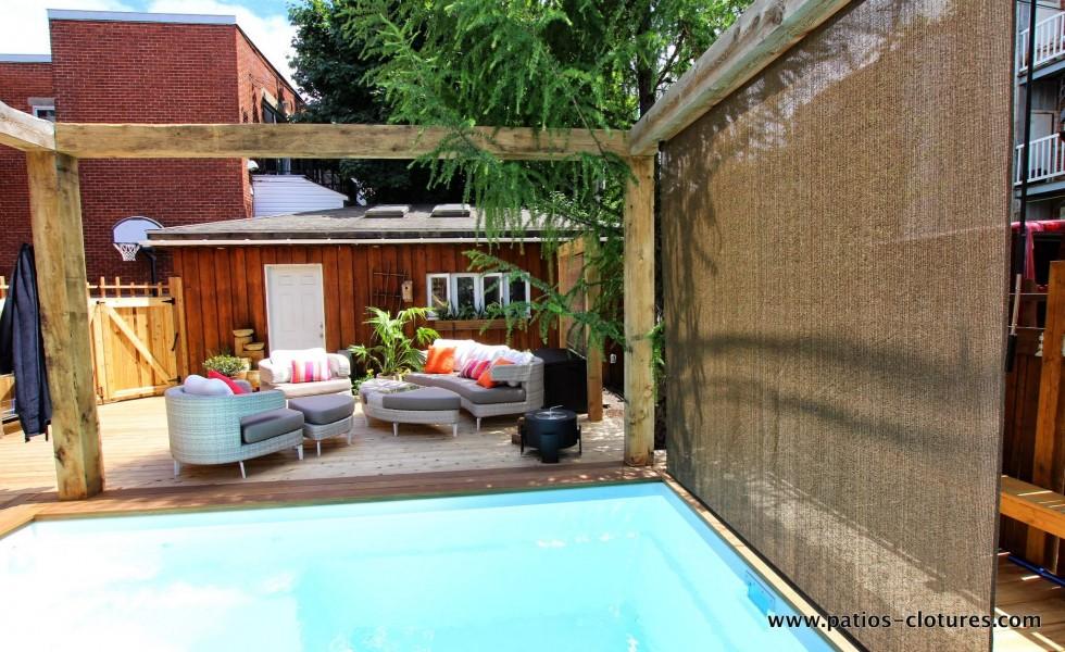 Écran en toile rétractable pour avoir de l'intimité dans la piscine
